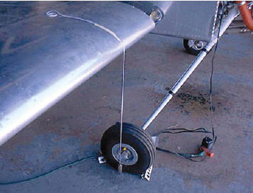 Figure 4-17. Plumb bob dropped from a wing leading edge.