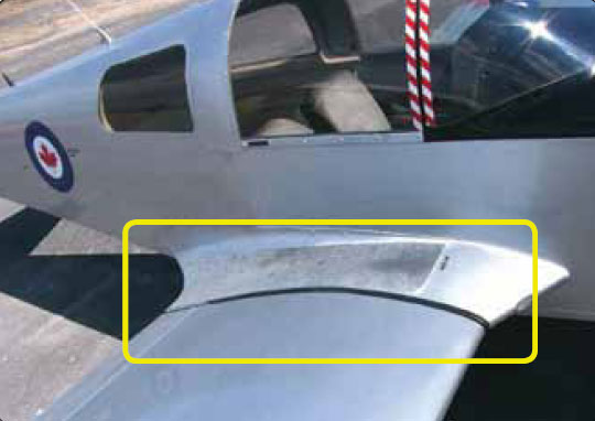 Figure 1-33. Wing root fairings smooth airflow and hide wing attach fittings.