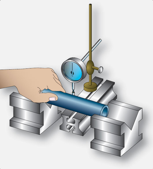Figure 10-14. Checking a piston pin for bends.
