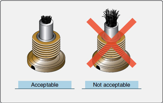 Figure 11-33. Inspecting the magnetic plug.