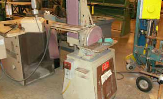 Figure 4-29. Combination disk and belt sander.