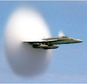 Figure 3-52. F-18 high-speed fly-by and a vapor cloud.