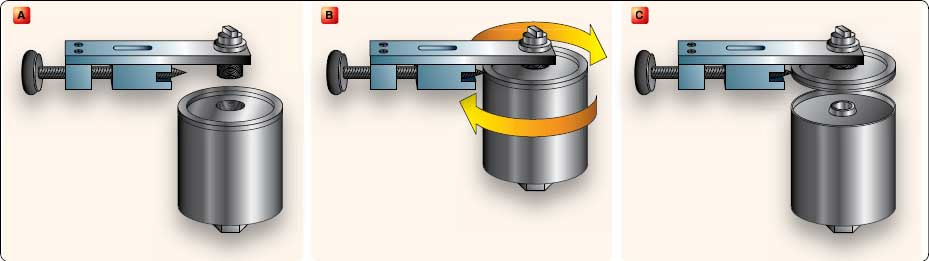 Figure 6-29. Cutting open a spin-on type oil filter using a special filter cutter.
