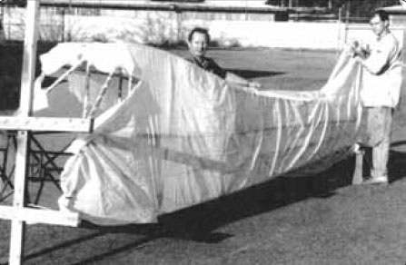 Figure 3-13. A custom-fit presewn fabric envelope is slid into position over a fuselage for the envelope method of fabric covering. Other than fitting, most steps in the covering process are the same as with the blanket covering method.