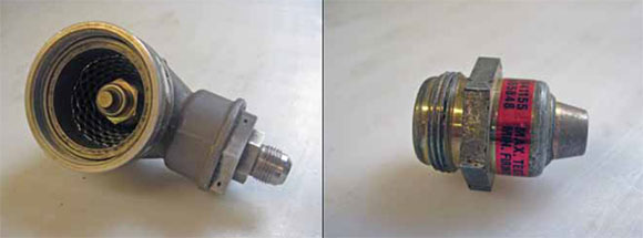 Figure 9-10. Discharge valve and cartridge (squib).