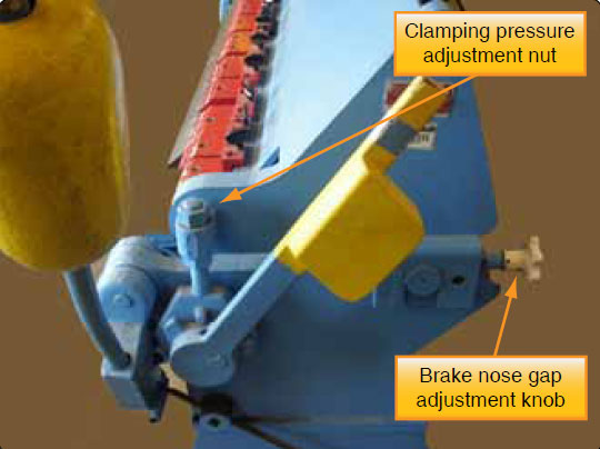 Figure 4-140. Adjust clamping pressure with the clamping pressure nut.