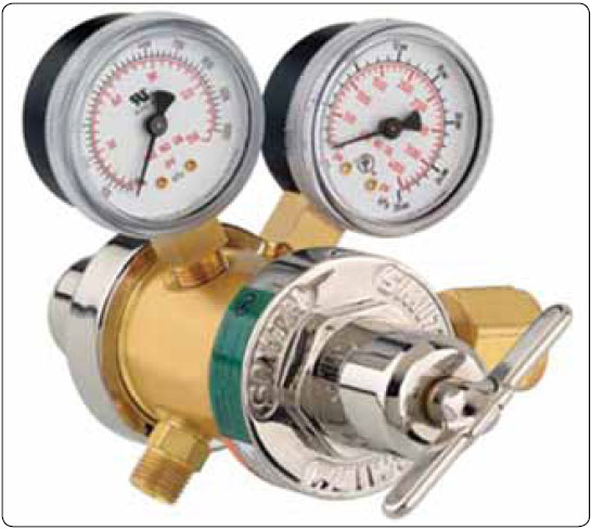 Figure 5-14. Two-stage oxygen regulator. No groove on the cylinder connection nut indicates a right hand thread.