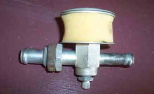Figure 10-89. A vacuum regulator, also known as a suction relief valve, includes a foam filter. To relieve vacuum, outside air of a higher pressure must be drawn into the system. This air must be clean to prevent damage to the pump.