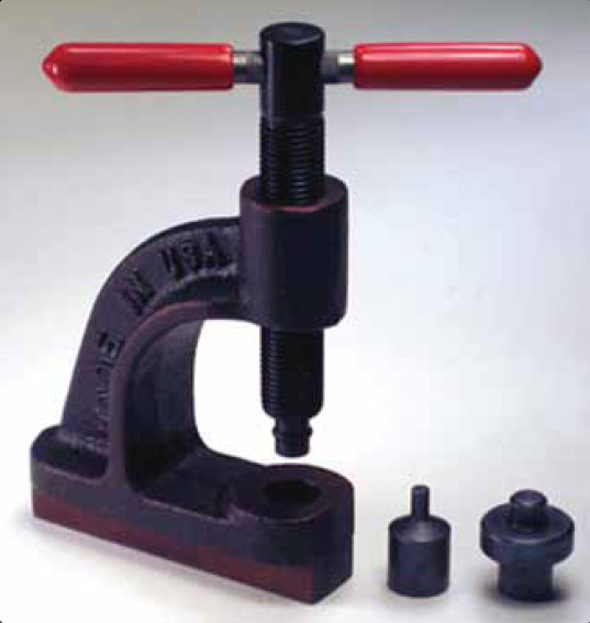Figure 13-124. Rivet setting tool is used to install brake linings on Cleveland brake pressure plates and back plates.