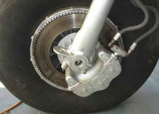 Figure 13-78. A single disc brake is a floating-disc, fixed caliper brake.