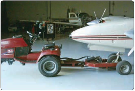 Figure 1-21. Typical smaller aircraft tow tractor.